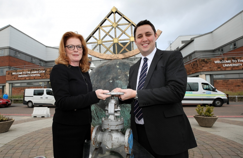 Siobhan McArdle, left, and Ben Houchen at James Cook University Hospital, holding a valve similar to the type that will be used in the district heating scheme