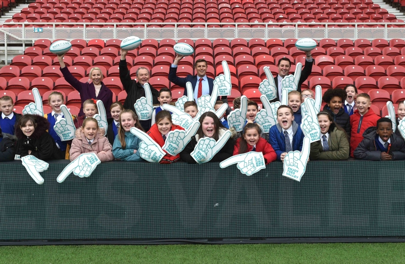 Pupils from Tees Valley schools celebrate the announcement at Middlesbrough's Riverside Stadium with Ben Houchen
