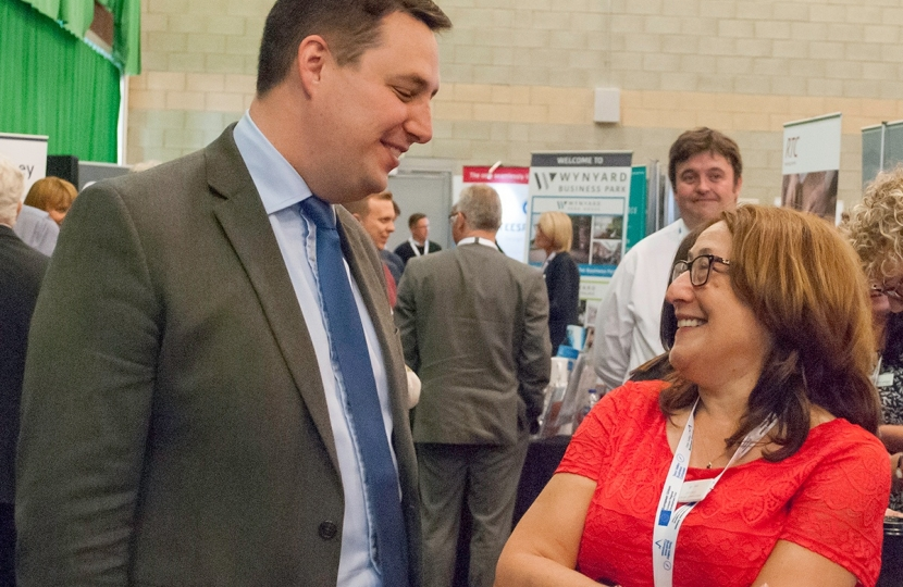 Tees Valley Mayor Ben Houchen speaking to an exhibitor at last year's Business Summit, and right, exhibitors at last year's Business Summit